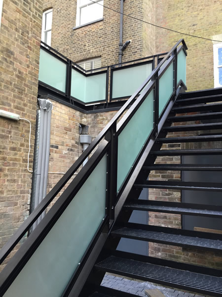 Black painted mild steel staircase and handrail with frosted glass - Exeter