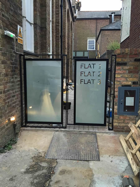 Black painted mild steel gate with frosted glass - Exeter
