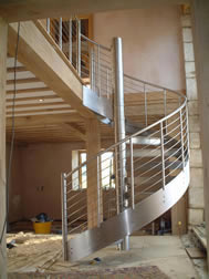 Stainless steel spiral staircase, barn conversion, Stroud