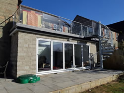 Stainless Steel and Glass Balustrade with a Galvanised Spiral Staircase