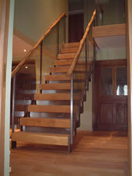 Stainless steel staircase with wood veneer