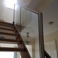 Stainless Steel Handrail fitted onto existing wooden staircase